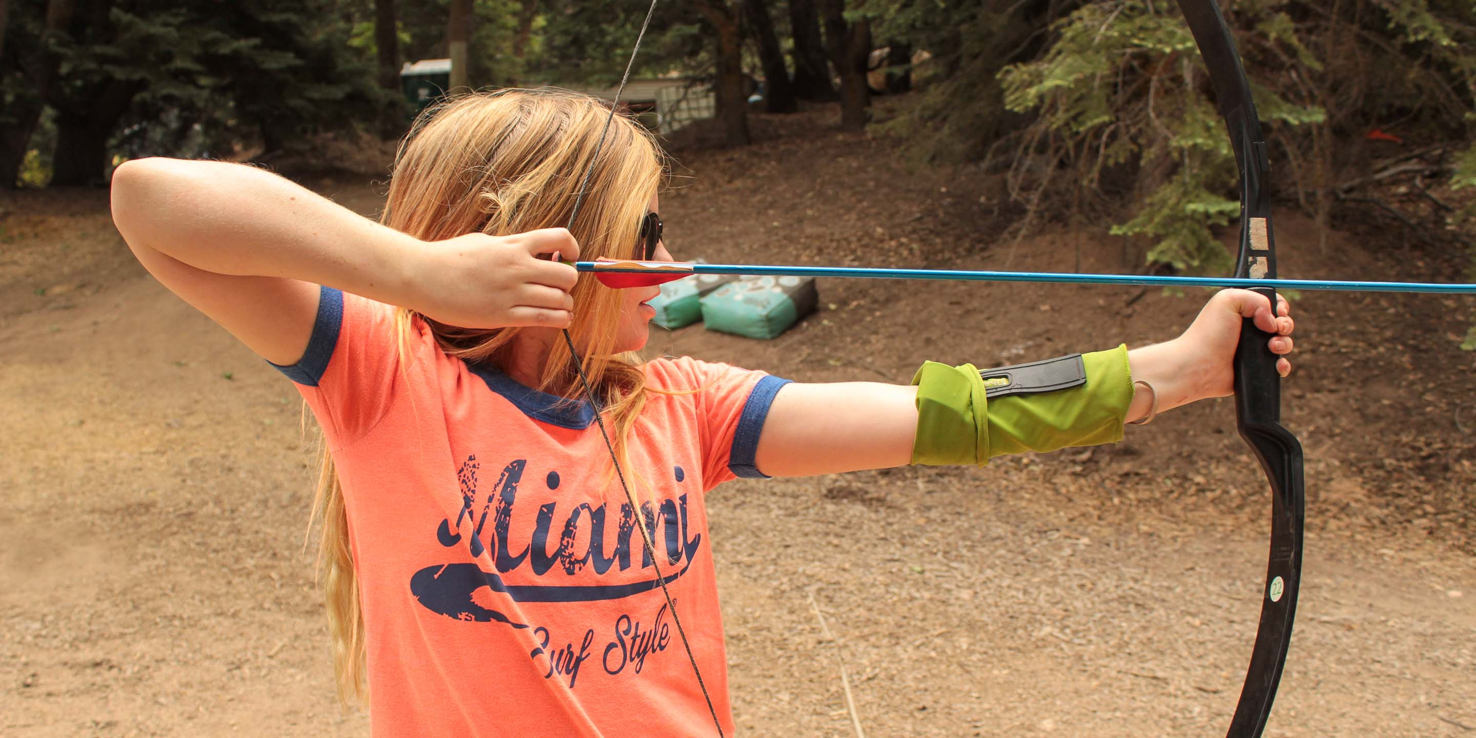 Girl shooting an archery arrow
