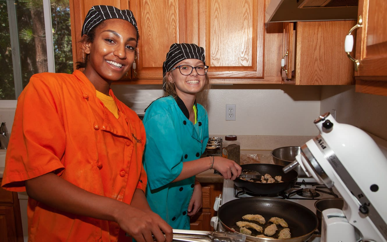 Two females during culinary activity