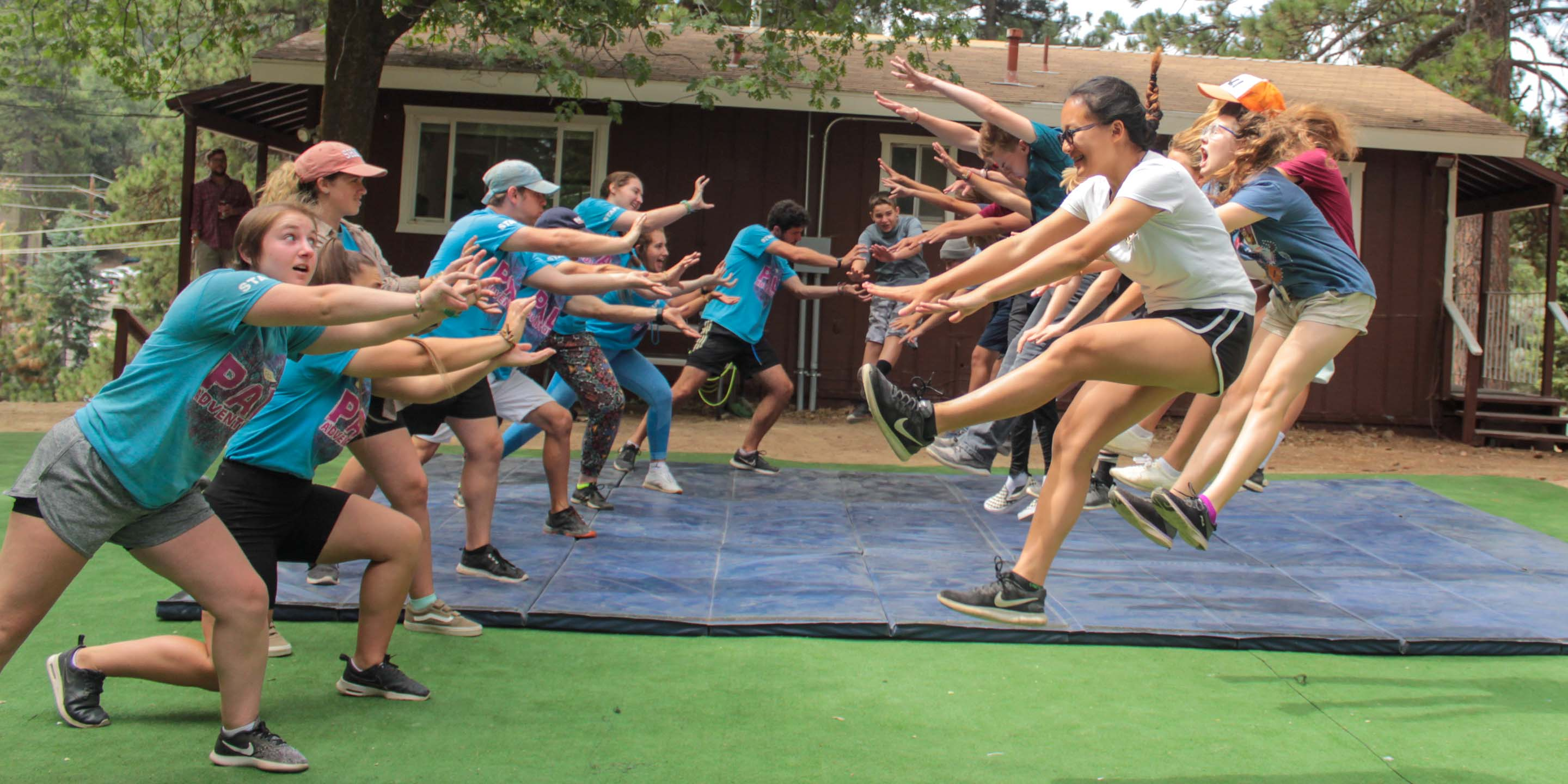 Staff and campers doing Hollywood stunts