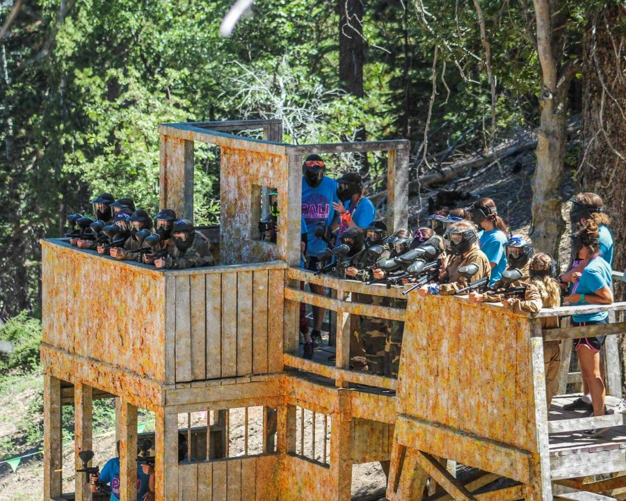 Large group of campers on paintball structure