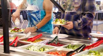 Campers serving themselves at salad bar
