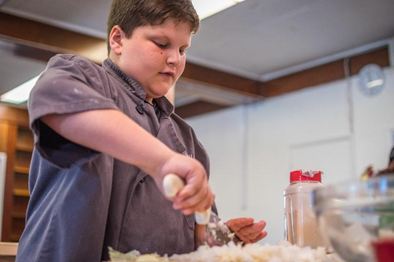 a boy making food