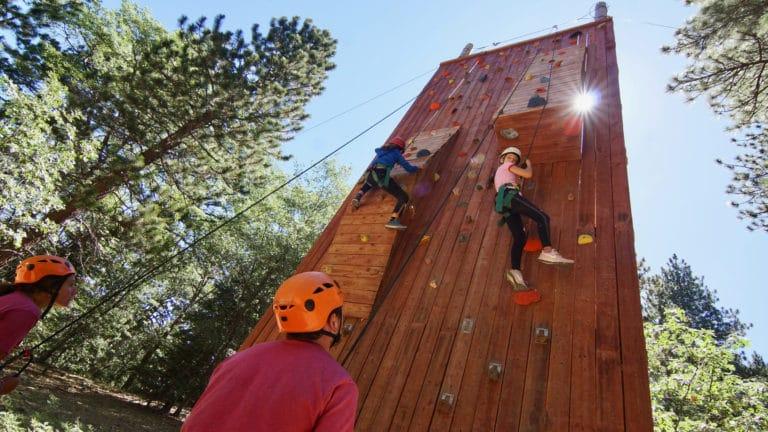 kids climbing a rock wall