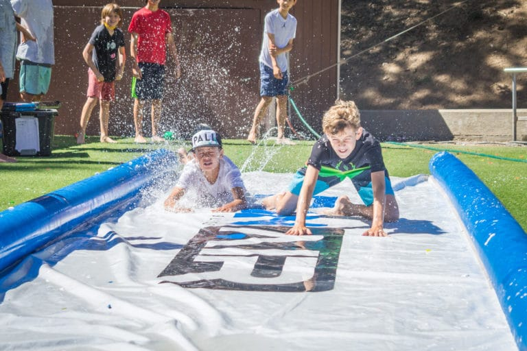 boys on a slip n slide