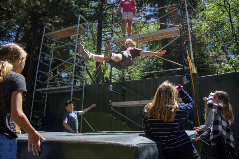 kids learning stunt techniques at camp