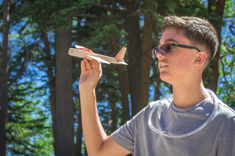 a boy holding a toy airplane