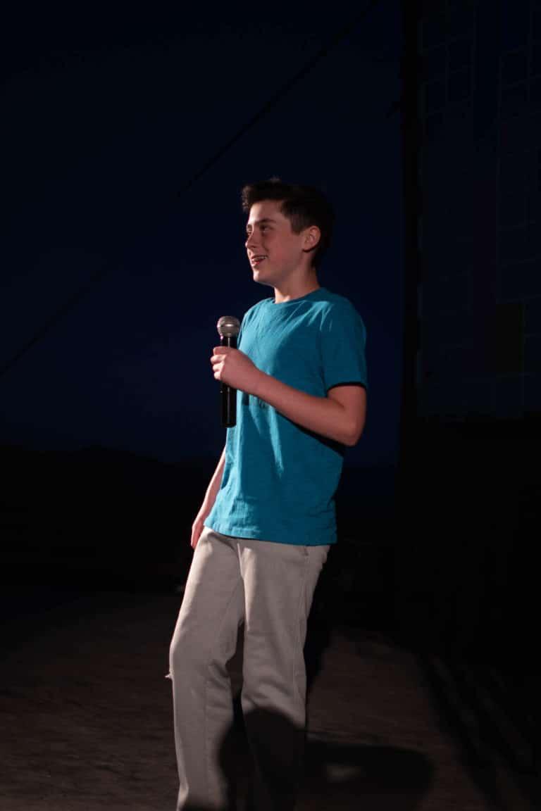 kid performing at comedy camp