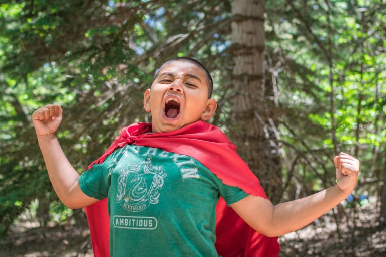 boy in red cape at LARP camp