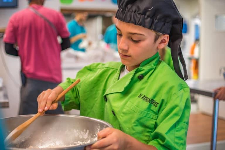 boy cooking at culinary summer camp