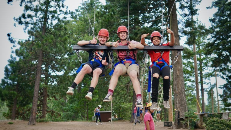 kids on giant swing at camp
