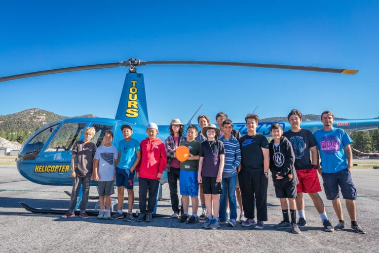 boys in front of helicopter