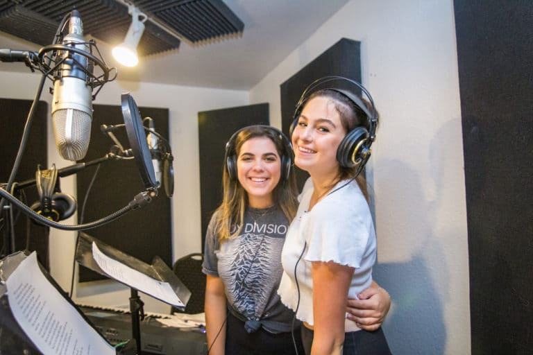 girls in recording booth at camp