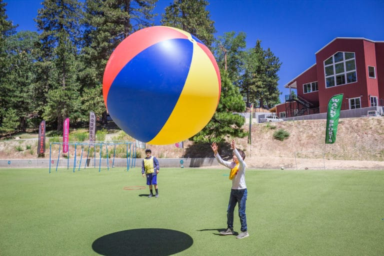 kid playing with large beach ball