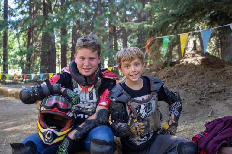 boys riding on dirt bikes