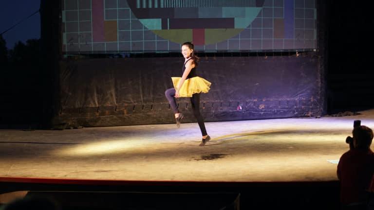girl performing in yellow tutu