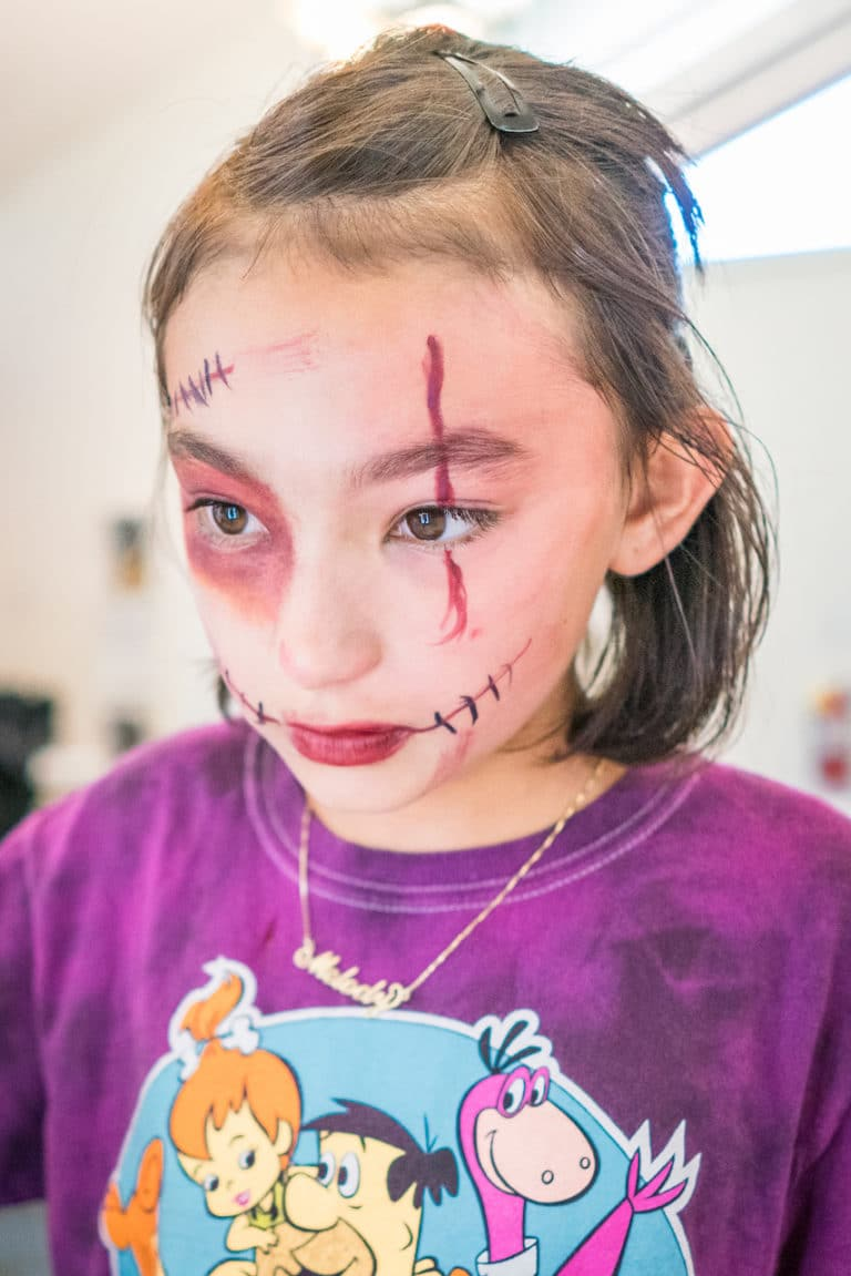 girl wearing zombie makeup