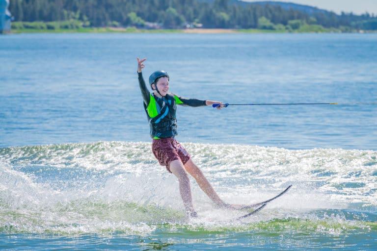 boy water skiing on lake at summer camp