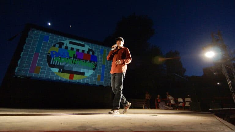 a man on stage doing stand up comedy