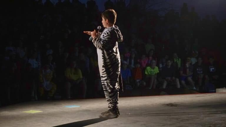 a boy in a zebra costume doing stand up comedy